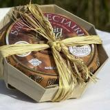Saint Nectaire cheese in an octagonal wooden container